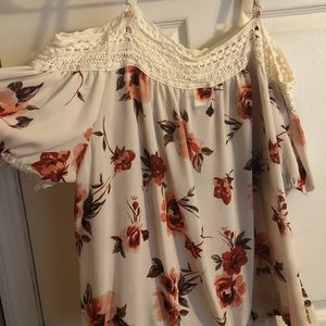 Cold shoulder sheer flowered top